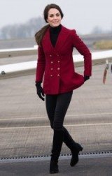 The Duchess of Cambridge visited an RAF base in Cambridgeshire on Valentine's day wearing a black turtle neck, deep berry red blazer, skinny jeans and a pair of suede knee high boots, Feb 2017.