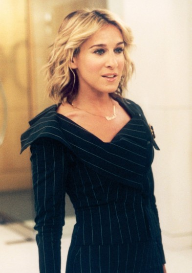 Carrie Bradshaw looking chic with new shorter hair style & Vivienne Westwood pinstripe suit