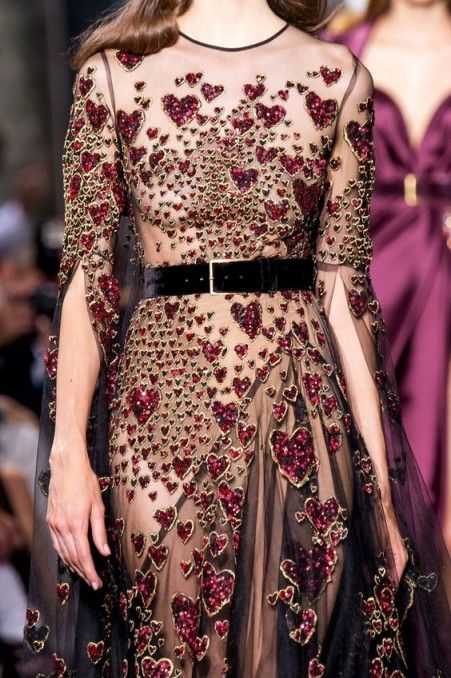 Jewelled red hearts on sheer Couture gowns