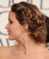 Jennifer Lawrence's glamorous wavy, low braided bun. Chic buns | elegant hairstyles | red carpet glamour | celebrity make-up and beauty