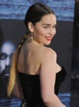 Emilia Clarke's stunning plait wrapped in gold ribbon. Celebrity braided hairstyles | hair and beauty | glamour