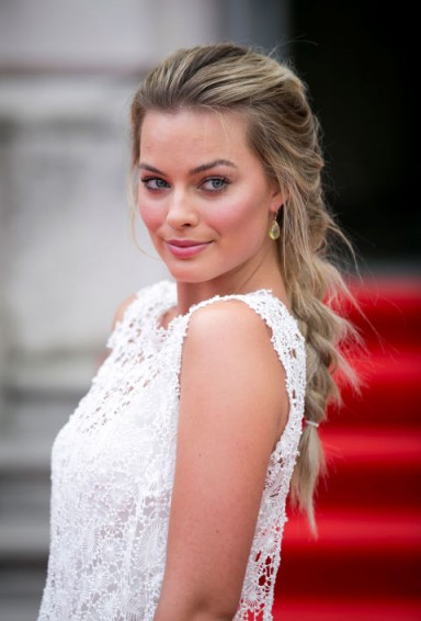 Margot Robbie's hair in a low, loose single braid