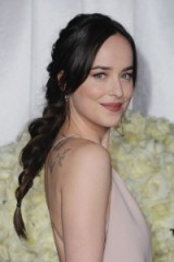 Dakota Johnson's thick messy braid at the Fifty Shades Darker premiere. Celebrity hairstyles | red carpet beauty | braids | braided hair