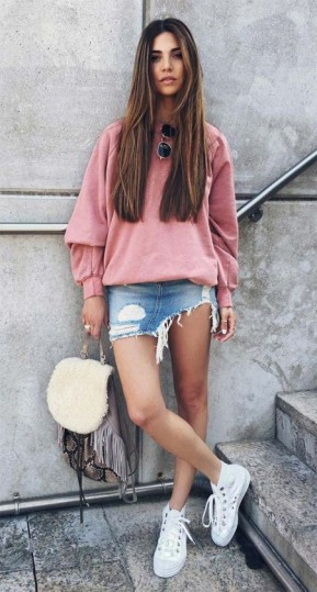 Pink sweatshirt & distressed denim mini skirt