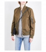 VALENTINO Rockstud Untitled shell bomber jacket in khaki. Designer casual jackets | luxe fashion | stud embellished | studded | pyramid studs
