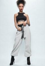 londunn + missguided grey fleeceback wide leg logo joggers. Jourdan Dunn fashion/clothing collaboration