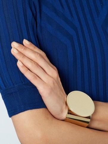 GIVENCHY Round disk cuff. Gold tone cuffs | designer fashion jewellery | wide bracelets - flipped