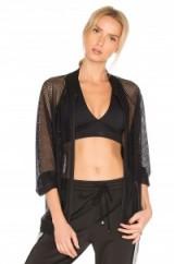 KORAL MESH BOMBER. Black sheer jackets | sports luxe fashion | sportswear