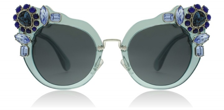 Miu Miu 04SS Transparent Azure Sunglasses, as worn by Elle Fanning arriving at Nice airport for the Cannes Film Festival, May 2017. Celebrity blue embellished eyewear – star style accessories –