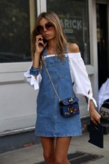 Denim pinafore dress over white bardot blouse | summer street style
