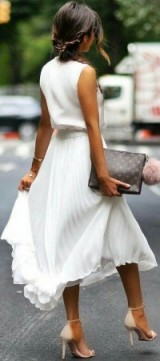 White pleated midi skirt and sleeveless top, accessorized with nude heels and Louis Vuitton clutch…perfect summer street style!