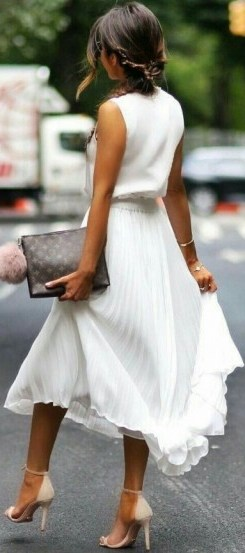White pleated midi skirt and sleeveless top, accessorized with nude heels and Louis Vuitton clutch…perfect summer street style! - flipped