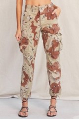 Jesy Nelson camouflage printed pants, Vintage Stonewashed Camo Surplus Pant from Urban Outfitters US site, the Little Mix singer posted a pic on Instagram wearing a pair of these trousers, 24 June 2017. Celebrity fashion | casual star style