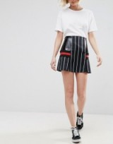 Jade Thirwall wore a black ASOS WHITE Pinstripe Skirt With Contrast Panels and a black ribbed funnel neck top, while attending the evian Live Young suite during Wimbledon 2017 at the All England Tennis and Croquet Club, 3 July 2017. Celebrity mini skirts | star style fashion