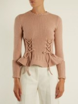 ALEXANDER MCQUEEN Lace-up fluted-hem wool-knit sweater ~ pink peplum sweaters ~ luxury knitwear