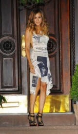 Sarah Jessica Parker as Carrie Bradshaw wearing a John Galliano newspaper print dress