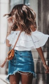 SEE BY CHLOÉ Polly Mini suede crossbody bag, white ruffle bardot top and a frayed hem denim mini skirt. bag available from mytheresa.com. Street style | summer outfit inspiration