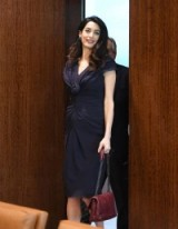 Amal Clooney style…dressed for business at the UN headquarters in New York, wearing a navy ruched front dress and carrying a burgundy bag