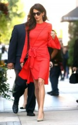Amal Clooney chic style…red side tie dress with fluted sleeves