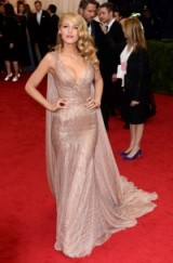 Blake Lively at the 2014 Met Gala wearing a plunging Gucci gown