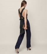 REISS LOLITA BACKLESS BOW-DETAIL JUMPSUIT INK / CROSS BACK JUMPSUITS / OCCASION FASHION