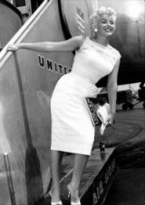 Marilyn Monroe in 1955 wearing a fitted white broderie anglaise dress, on her way to attend the Bement Centennial in Bement, Illinois. vintage fashion – 50s dresses