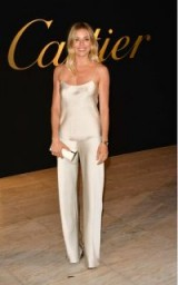 Sienna Miller wearing an ivory silk cami and matching pants from The Row, May 2017.