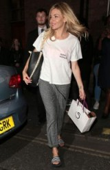 Sienna Miller's casual style…white tee, grey joggers and striped slides
