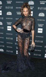 Joan Smalls wearing a sheer fitted Zuhair Murad gown with feather train at the Harper's Bazaar Celebrates ICONS by Carine Roitfeld event, during NYFW, September 2017. Celebrity glamour ~ star style gowns