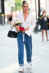 Bella Hadid out in New York wearing a fitted cropped white shirt and relaxed low waist jeans