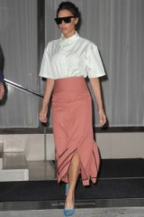 Victoria Beckham looking stylish in a white shoulder pad shirt, pink slit hem midi skirt and azure blue pointed pumps – women with style