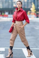 Olivia Culpo stylish in a red and beige outfit ~ women with style