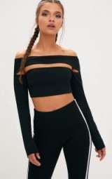 PRETTY LITTLE THING BLACK CUT OUT BARDOT LONG SLEEVE CROP TOP