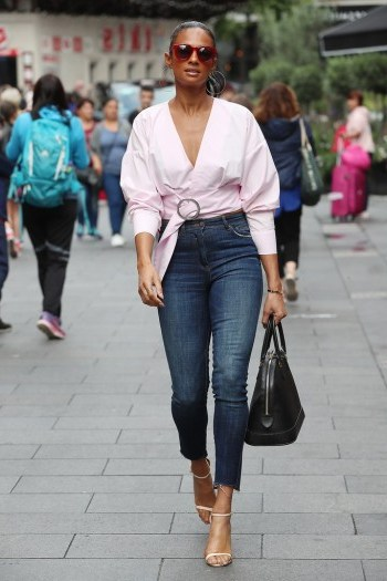 Blush wrap top, high waist skinny cropped jeans with a pair of strappy heels and you have the perfect casual glam look…of course it helps if you're gorgeous too! - flipped