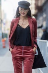 Street style NYFW S/S 2018…rose velvet trouser suit, black lace trim cami and a baker boy cap – stylish outfits