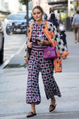 Olivia Palermo street style out in New York, wearing a crochet cropped leg jumpsuit with embroidered mules, September 2017.