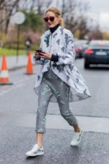 Olivia Palermo style wearing a grey printed Moncler jacket and cropped pants.