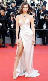 Bella Hadid channeling pure Hollywood glamour on the red carpet at Cannes 2017 in May, dressed in a nude strapless Alexandre Vauthier plunge front silky gown and Bulgari jewels.
