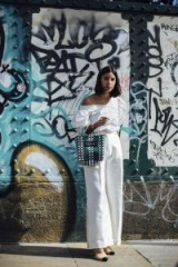 Street style during London Fashion Week Spring 2018 | ruched top and wide leg pants