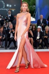 Stella Maxwell hit the red carpet at the Venice Film Festival wearing a pink satin one shoulder strap custom made gown from TWINSET. Celebrity gowns | designer dresses