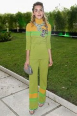 Kieran Shipka wore this Miu Miu green and orange knit turtleneck belted top and matching trousers, during the 2017 Venice Film Festival. Best celebrity looks | designer outfits