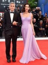 Amal Clooney looked stunning when she accompanied husband George on the red carpet, wearing a lilac Atelier Versace gown, at the 2017 Venice Film Festival. Designer gowns | best celebrity looks
