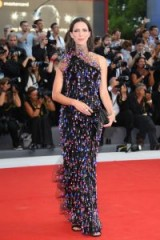 Rebecca Hall on the red carpet wearing a stunning black Armani Privé one shoulder gown, fringed with pink and blue sequins, at the Downsizing premiere, 2017 Venice Film Festival.