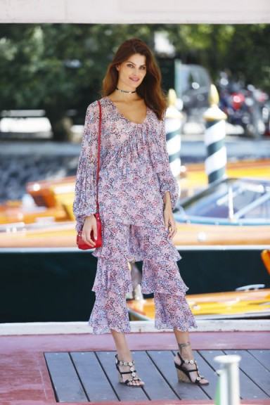 Isabeli Fontana In Philosophy di Lorenzo Serafini arriving at the 2017 Venice Film Festival wearing a pair of lilac tiered cropped pants and matching blouse.