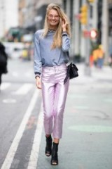Romee Strijd grey long sleeve crew neck top, tucked in to metallic pale pink cropped trousers and black peep toe ankle boots