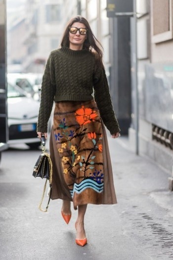 Giovanna Battaglia Engelbert street style…floral skirt, chunky knit and orange pointed toe pumps. - flipped