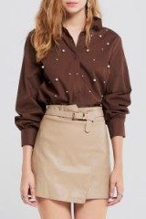 STORETS Amelie Leather Mini Skirt With Belt | beige faux leather asymmetric skirts