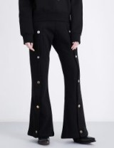 BLINDNESS Flared high-rise cotton-jersey jogging bottoms | black button embellished joggers