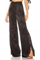 Chrissy Teigen X REVOLLVE MATCHA PANT   black silky wide leg pants   side slit trousers