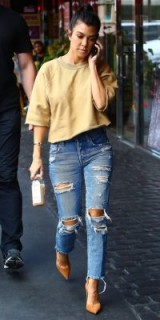 Kourtney Kardashian street style…beige cropped uneven trimmed sweatshirt, ripped jeans and tan suede pointy pumps